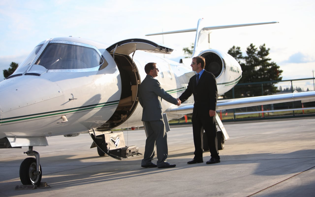 Businessman getting on Corporate Jet